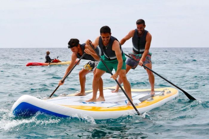 tennis players paddle boarding