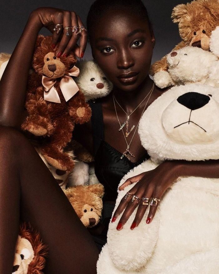 model with teddy bears