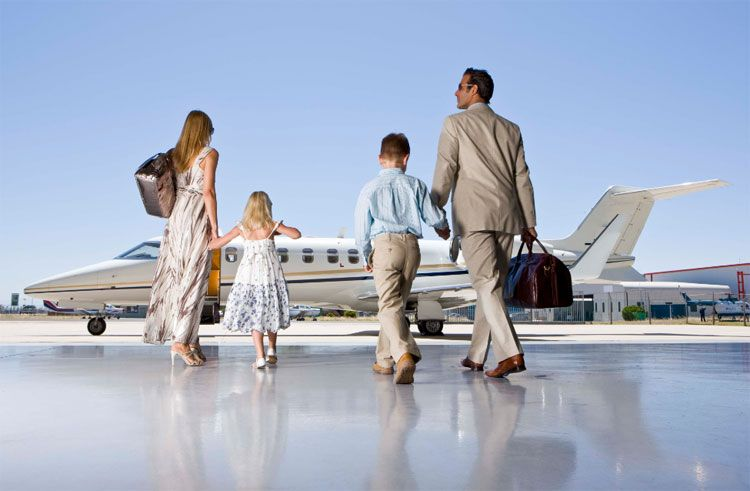 family getting on private jet