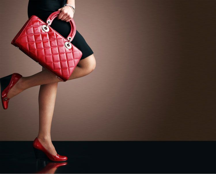 woman shopping red handbag
