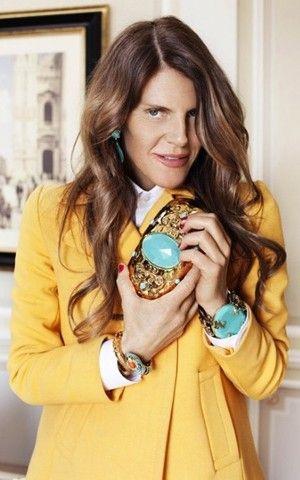 Anna Dello Russo Clutches one of her new designs