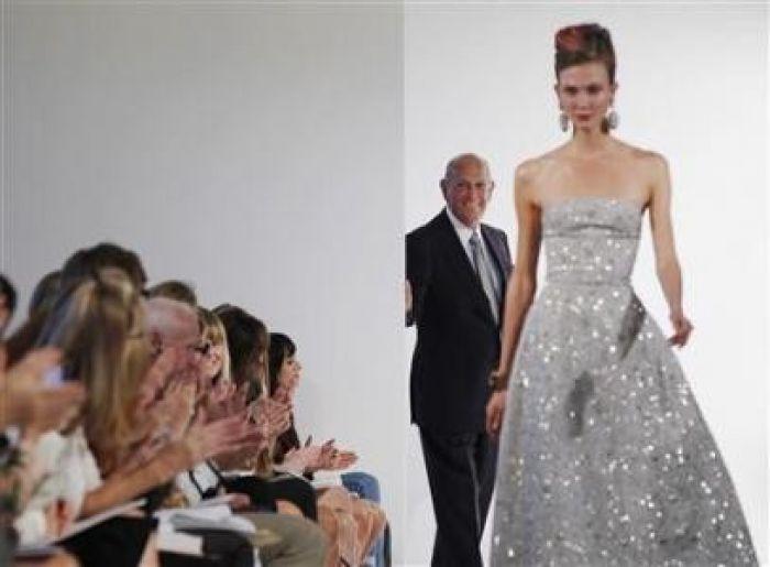 Designer Oscar De La Renta watching his fashion show