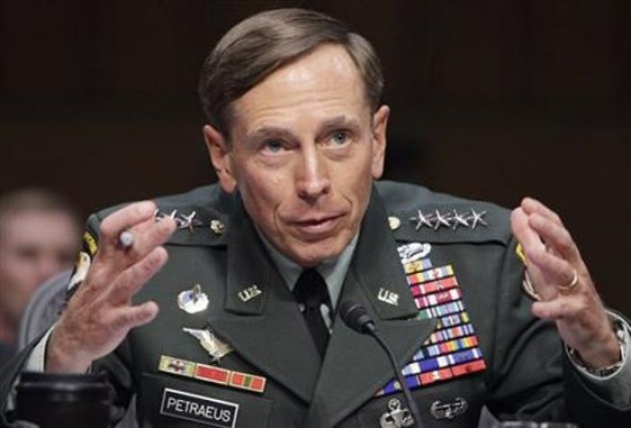 U.S. General David Petraeus gestures during the Senate Intellig