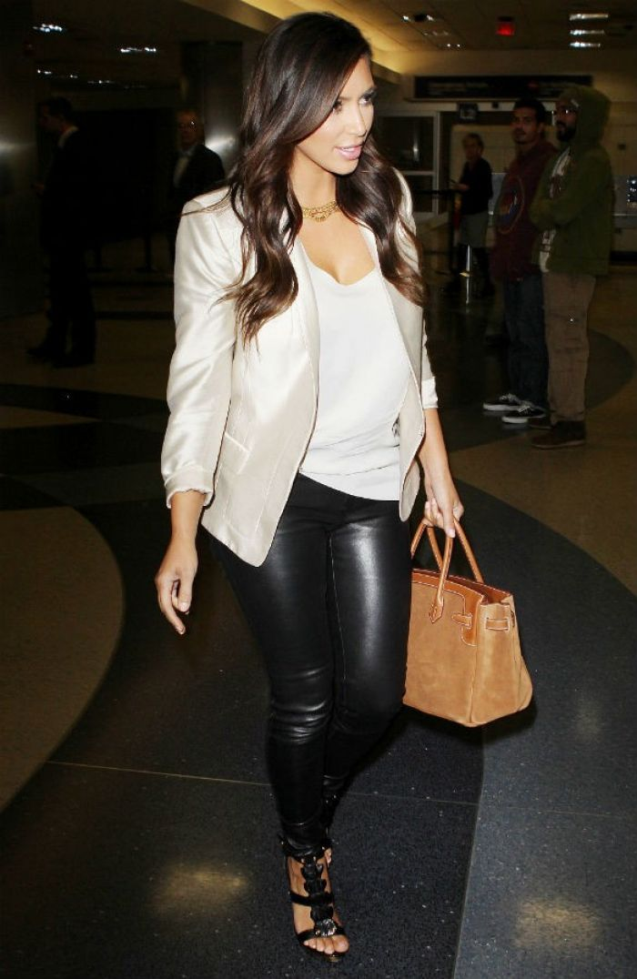 Kim Kardashian in leather pants and neutral colors
