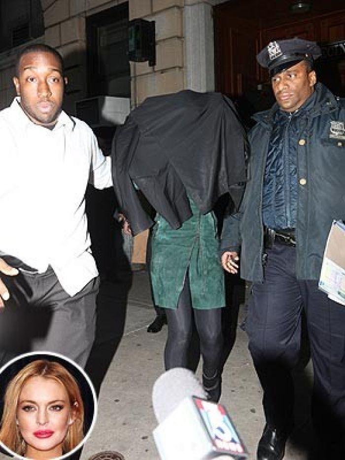 Lindsay Lohan leaving precinct station in NYC