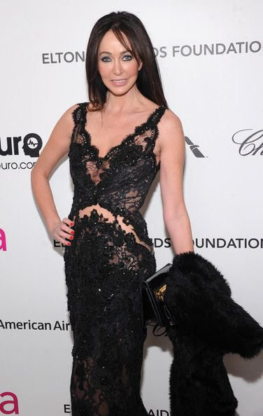 Melanie Mar in Hayari Paris Gown during the annual Elton John