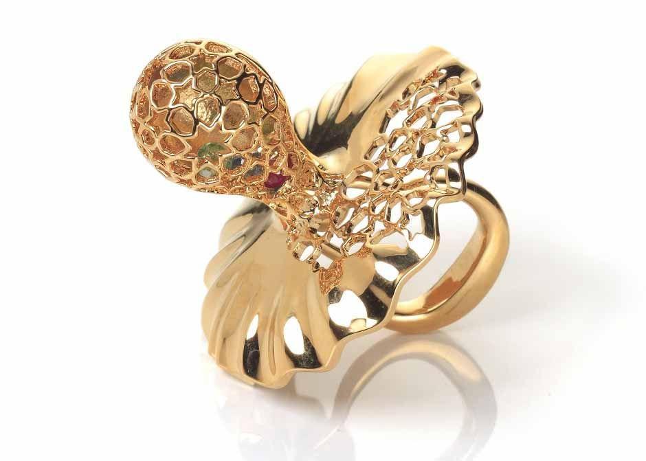 Merdinger House of Design, gold pacifier