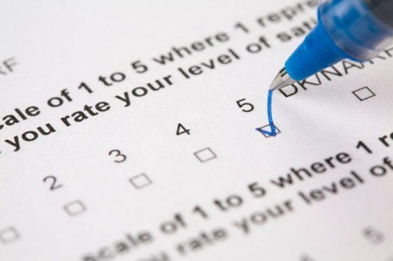 survey with gold pen