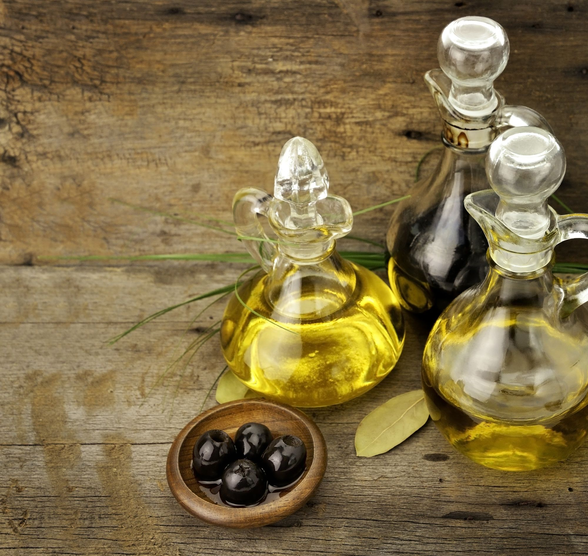 olive oil bottle and olives