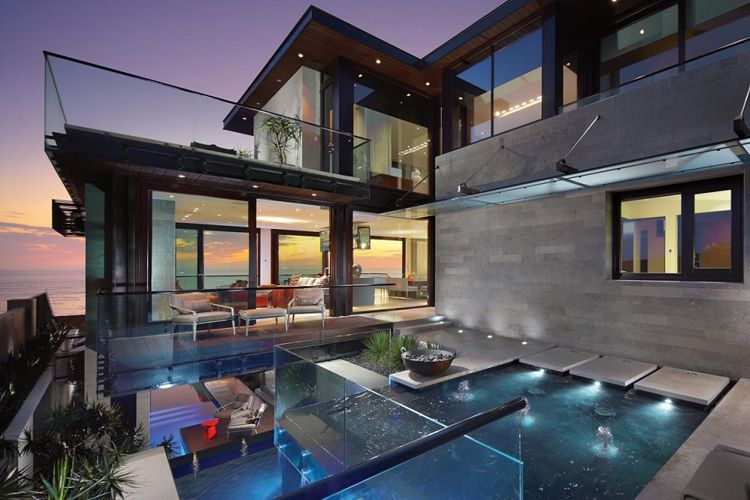Layered Reflecting Pools and Glass Walls Open The Strand Reside