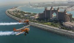 Breitling Wingwalkers Perform Gymnastics While Strapped to Planes and Soaring Through the Skies of Dubai (Just Watch It)