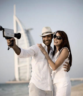 couple standing in front of burj al arab hotel
